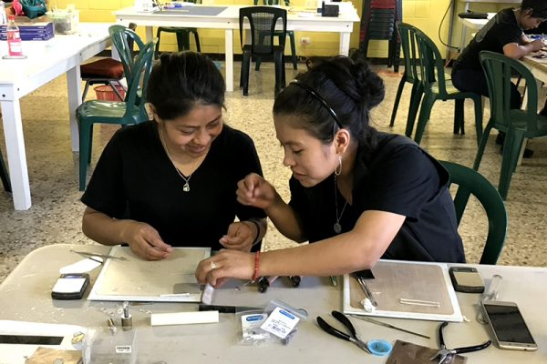 Apprentice Carolina learns from Elida in the Milagros Workroom