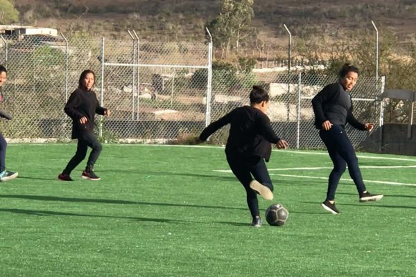 Carolina, Maria, Ilma, and Emili unwinding at the end of the work week with a soccer scramble