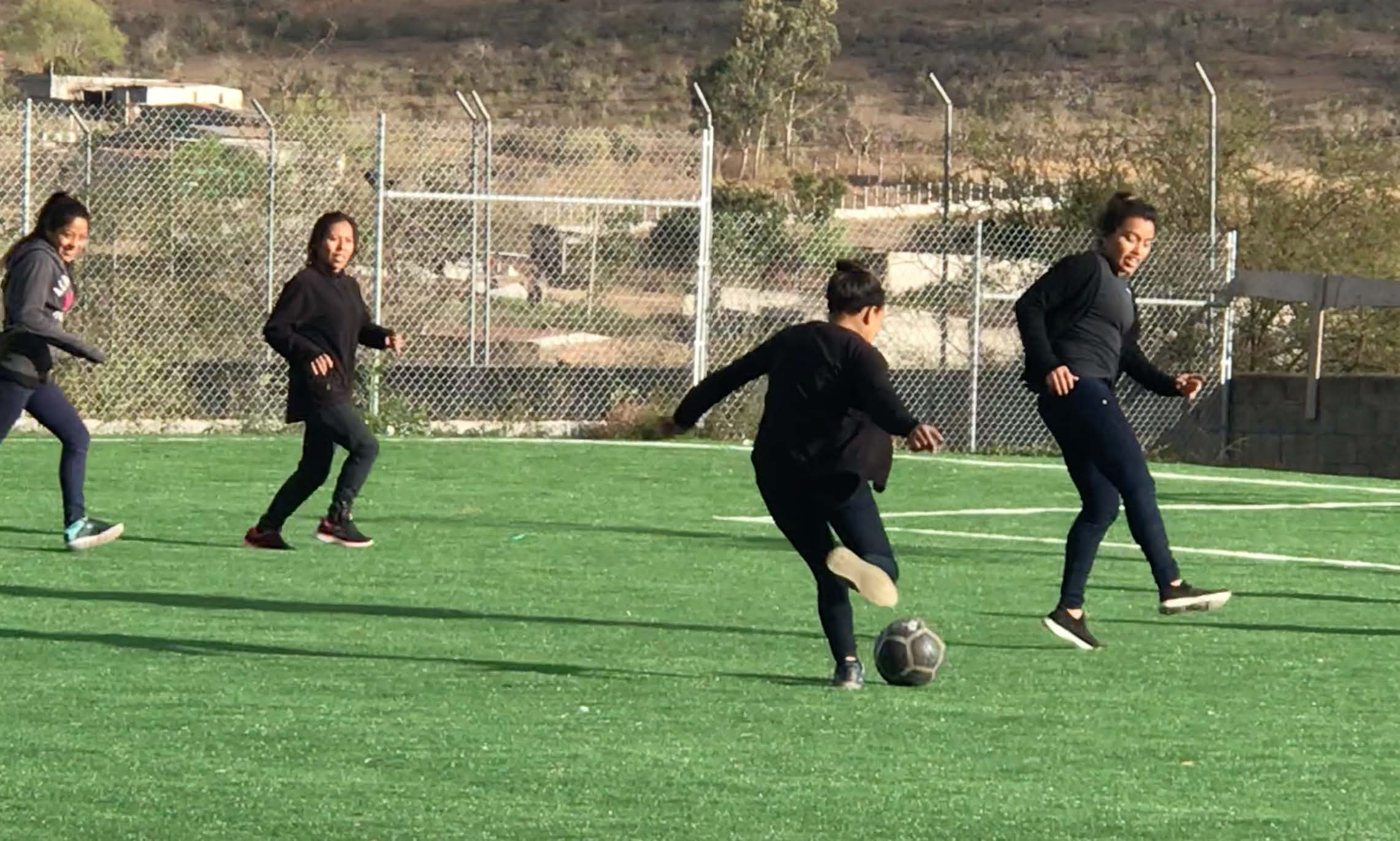 Carolina, Maria, Ilma, and Emili unwinding at the end of the work week with a soccer scramble